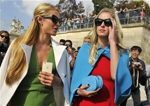 Paris and Nicky Hilton arrive at Valentino's Ready to Wear collection show in Paris.