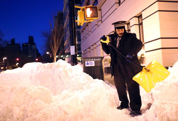 New York State imposes travel ban as city garbled by snow