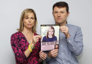 Kate and Gerry McCann are seen posing with a computer generated image of how their missing daughter Madeleine might look, during a news conference in London in this May 2, 2012 file photograph. On Monday the BBC's Crimewatch programme will air a new appeal to help find Madeleine McCann who went missing from a holiday villa in southern Portugal in May 2007. REUTERS/Andrew Winning/Files (BRITAIN - Tags: CRIME LAW SOCIETY)