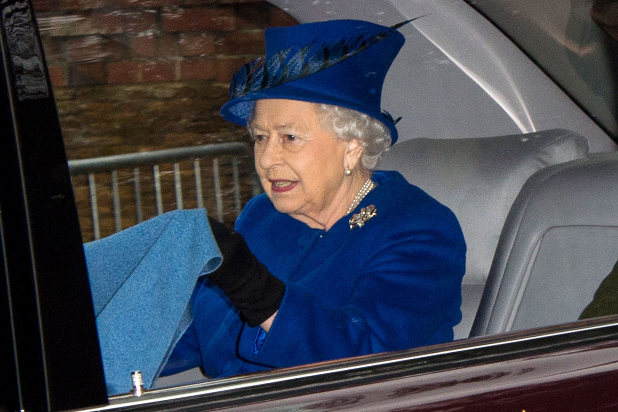 Queen Elizabeth emerges for the first time since falling ill with heavy cold